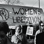 A group of Black women, under a 'Women's Liberation' banner, march in support of the Black Panther Party, New Haven, Connecticut, November 1969.