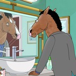 BoJack Horseman, an animated horse, stands at a bathroom sink and looks at himself in the mirror. He wears a sweater and a concerned look.