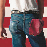 The Born in the U.S.A. album cover features a man's butt in jeans standing in front of a red, white, and blue American flag
