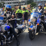 Police officers on stationary motorcycles at Boston Straight Pride