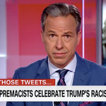 "Jake Tapper hosting his CNN show, the chyron reads ""white supremacists celebrate Trump's racist tweets"""