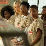 a group of white and Black inmates stand in the chow line on Orange is the New Black