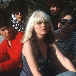 Blondie frontwoman Debbie Harry, surrounded by bandmates