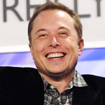 Elon Musk smiling while speaking at an event