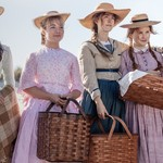 four white women dressed in mid-century dresses in Little Women