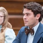 Zac Efron plays Ted Bundy, an average-looking white man wearing a blue suit, in Netflix film