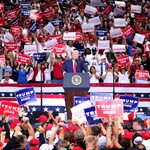 "U.S. President Donald Trump speaks during a ""Keep America Great"" Campaign Rally. Signs in the back read ""Latinos for Trump."""