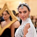 Gal Gadot wears a glittering headpiece during the Met Gala.