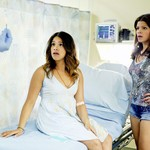 two Latina women, Gina Rodriguez and Andrea Navedo, look shocked as doctor holds up pregnancy test