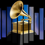 A gold gilded Gramophone trophy against a black background with blue stripes