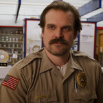 A photo of David Harbour, a white man with brown hair, as Jim Hopper in Stranger Things.