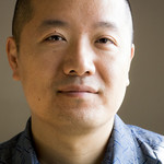 a photo of a bald Asian American man