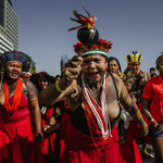 Indigenous women are taking part in a protest against right-wing President Bolsonaro's environmental policies