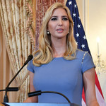 Ivanka Trump addresses an unseen audience while standing behind a podium with a U.S. Department of State flag beside her