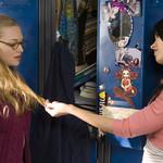 Megan Fox playing with Amanda Seyfried's hair at their lockers in Jennifer's Body