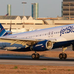 A JetBlue plane taking off from runway
