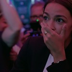 a Latinx woman covers her mouth in shock after she wins an election