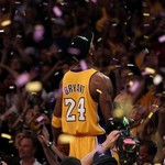 Kobe Bryant in gold Lakers uniform surrounded by confetti.