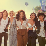"The cast of ""The L Word: Generation Q"" stands with their arms around each other."