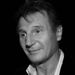 A black and white image of Liam Neeson