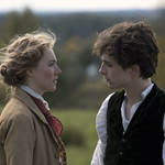"Saoirse Ronan and Timothée Chalamet in ""Little Women,"" having a serious conversation"