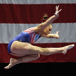 Maggie Nichols, a white, female, gymnast, bends over at the waist while bent at the waist tin Athlete A