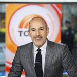 Matt Lauer, a white man who is balding, stands on a stage while anchoring the TODAY Show