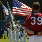 Minor league player watching National Anthem