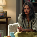Nalini Vishwakumar wears a loose-fitting green shirt, her hair dark and wavy, and sits in a therapists office looking somber.