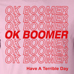 a pink t-shirt that states OK Boomer over and over again in dark red letters
