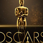 A gold Oscars trophy behind the Oscars logo against black text