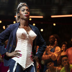 Angelica Ross with her hands on her hips, looking defiant as she walks a category