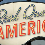 a red, blue, and white sign that says Real Queer America