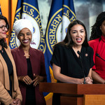 four Representatives—two Muslim women, one Latina woman, and one Black woman—stand behind a podium together