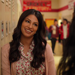 Richa Shukla plays Kamala, an Indian woman with long, brown hair, in Never Have I Ever
