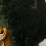 A close up of a Black woman's hair.