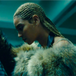 Beyoncé, a light-skinned Black woman wearing cornrows, poses in profile in the visual album for Lemonade