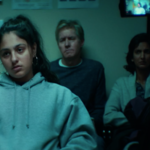Mandy from HBO's share is at the police station with her parents. She is wearing a sweatshirt and she looks upset.