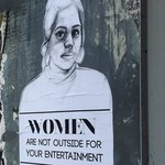 a sign in Brooklyn reads Women are Not Outside for Your Entertainment