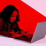 an illustration of a child laying in front of a computer with a red light overlaying their body