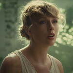 Taylor Swift plays the piano while wearing a white dress in a lush forest.