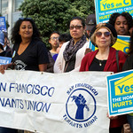 a group of women of color rallying with Yes on C signs
