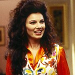 Fran Drescher as Fran Fine, a white Jewish woman with long, curly, brown hair, inThe Nanny. She is wearing an orange blouse with a flowered vest layered over it.