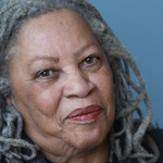 Author Toni Morrison smiles against a blue background