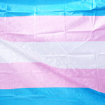 The transgender flag features light blue, pink, and white stripes