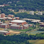 An aerial view of UNC Charlotte and the surrounding landscape