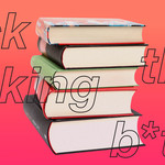 "A photo of books with the text, ""f*ck that f*cking b*tch."""