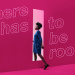 "A Black woman with natural hair and a dress steps into a doorway. A text overlay reads, ""there has to be room."""