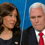Kamala Harris, who is brown with dark brown, curled hair, smirks at Mike Pence, who is old and white with bright white hair and looks away from the camera with his lips pursed.