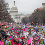 A huge crowd of protestors with colorful signs outside of the U.S. Capitol
